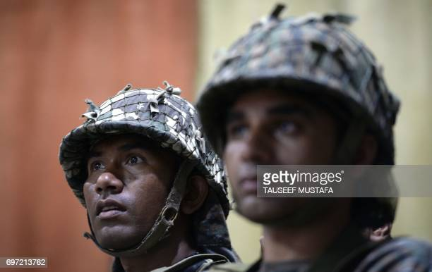 TOPSHOT Indian paramilitary troopers in Kashmir watch the IndiaPakistan cricket final match taking place in London at their camp in Srinagar on June...