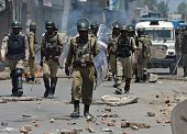 Indian paramilitary troopers patrol after a clash with Kashmiri protestors in Srinagar on July 23 2016 Large parts of Indianadministered Kashmir have...