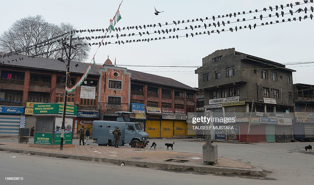 Indian paramilitary troopers patrol during a one day strike in Srinagar on December 31,2012. Shops and businesses are shut in Kashmir in response to a strike called by separatist groups to protest shooting by government forces that wounded seven civilians. Last week Indian troops shot dead two suspected Islamic militants in Kashmir while seven civilians received bullet injuries when they protested the slaying of the rebels, officials said. AFP PHOTO/ Tauseef MUSTAFA