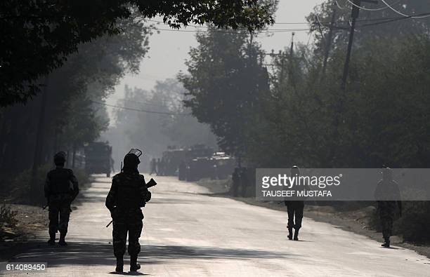 TOPSHOT Indian paramilitary troopers patrol on the third day near the site of a gunfight between the Indian army and suspected militants in Pampore...