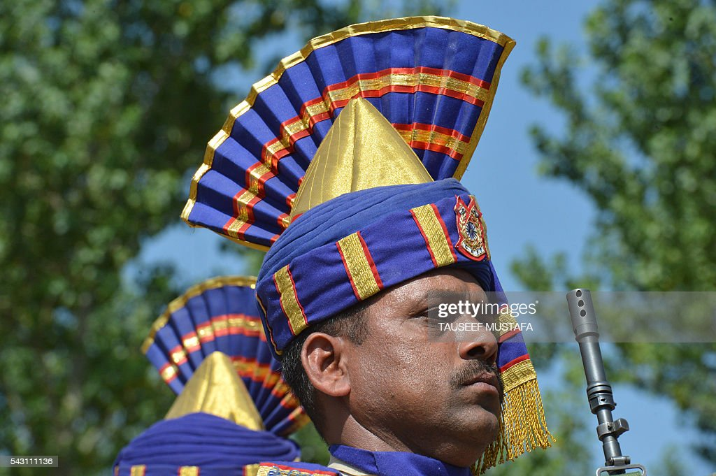 Indian paramilitary troopers present arms during a wreath-laying ceremony for eight colleagues killed in an ambush in Srinagar on June 26, 2016. At least eight Indian paramilitary soldiers and two suspected rebels were killed June 25 near Srinagar in India-administered Kashmir when a group of armed militants ambushed the soldiers' convoy, police said. Four militants sprayed bullets on the convoy carrying members of India's Central Reserve Police Force (CRPF) near Pampore town, killing five soldiers instantly and wounding 20, inspector general of police for the region, Javaid Gillani, told AFP. / AFP / TAUSEEF
