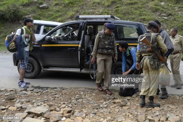 Indian paramilitary troopers search bags of Hindu pilgrims at Pahalgam in Anantnag district southeast of Srinagar during the annual Hindu pilgrimage...