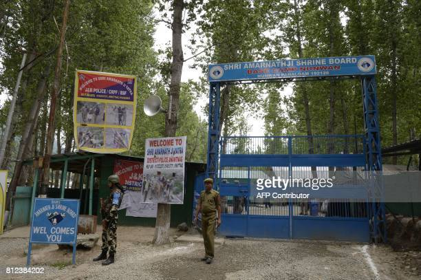 Indian paramilitary troopers stand guard outside the pilgrimage base camp at Pahalgam in Anantnag district southeast of Srinagar during the annual...