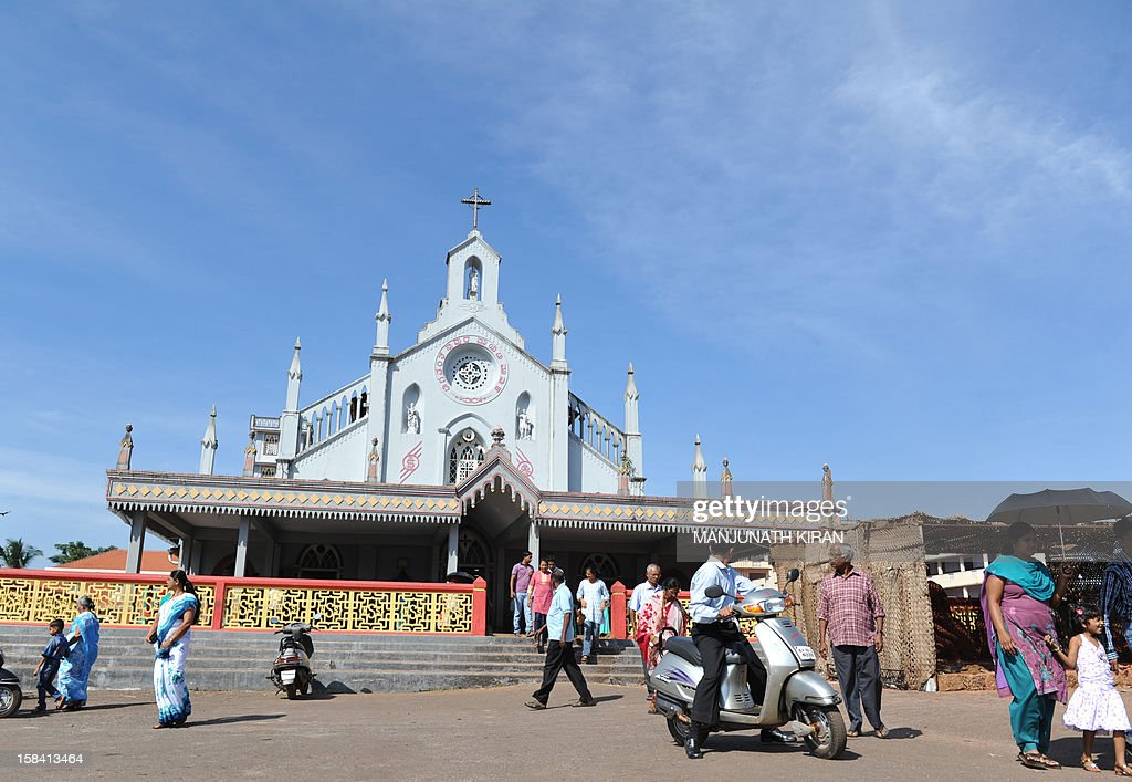 Indian parishioners walk out of the Shirva church after a prayer meeting north of Mangalore on December 16, 2012. The body of an Indian-born nurse, Jacintha Saldanha, 46, was found dead after taking a hoax call to the hospital treating Prince William's wife was due to arrive in Mangalore following a mass in her memory held in London. Saldanha was found hanged days after answering the prank telephone call from two Australian radio DJs posing as British royals to the hospital where Catherine was admitted during the early stages of her pregnancy. AFP PHOTO/ Manjunath Kiran