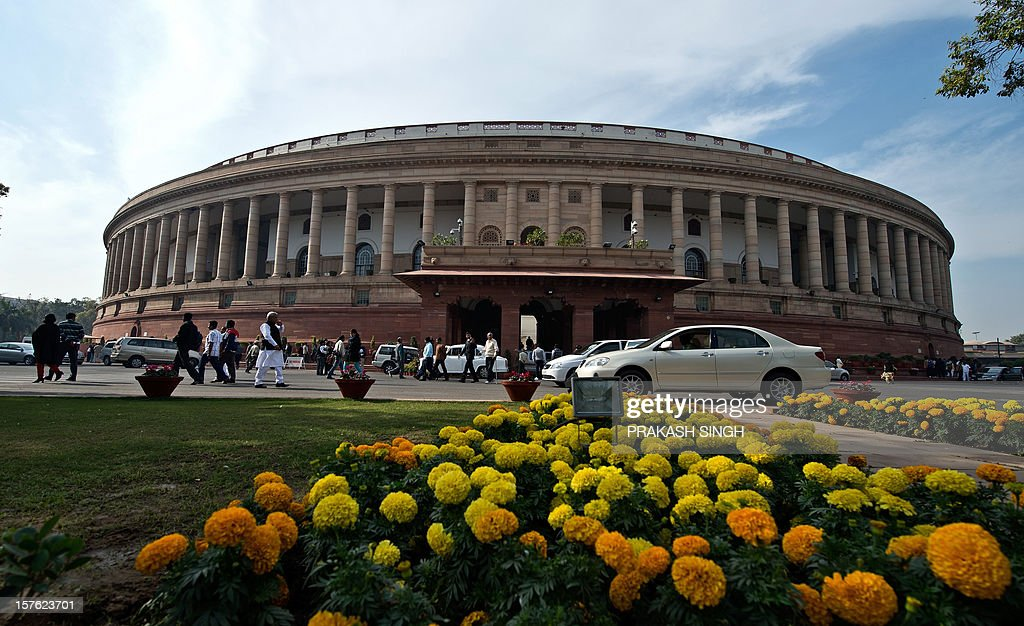 Indian parliamentarians leave after the Rajya Sabha (Uppar House) adjourned at Parliament house during the winter session in New Delhi on December 5, 2012. India's government, which lost its majority in September, faced a test of its ability to marshal support in parliament on Wednesday with a vote on a contentious recent reform of the retail sector. After two days of stormy debating in the rowdy lower house, lawmakers are set to pass judgement on new rules opening up the highly protected retail sector to foreign supermarkets that are being allowed in for the first time. AFP PHOTO/ Prakash SINGH
