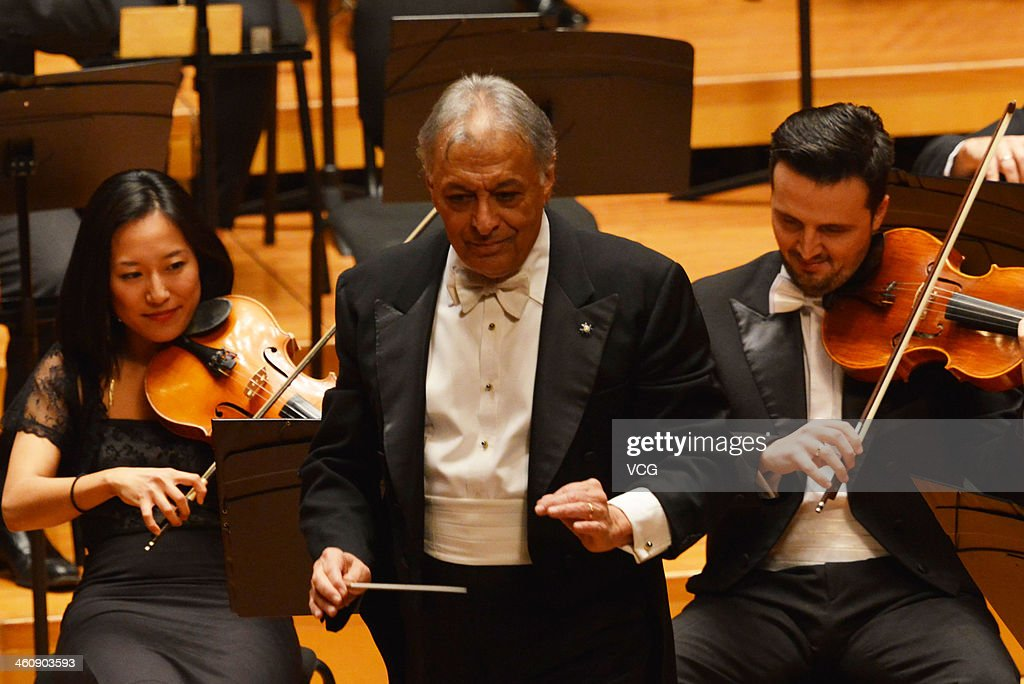 Indian Parsi conductor <a gi-track='captionPersonalityLinkClicked' href=/galleries/search?phrase=Zubin+Mehta&family=editorial&specificpeople=548623 ng-click='$event.stopPropagation()'>Zubin Mehta</a> performs with the Orquestra de la Comunitat Valenciana orchestra during the New Year's concert at Qintai Concert Hall on January 5, 2014 in Wuhan, China.