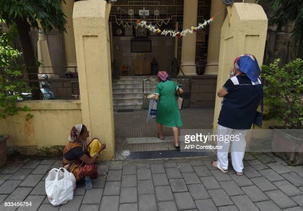 Indian Parsis arrive at a Fire Temple to offer prayers during Navroze the Parsi New Year in Mumbai on August 17 2017 Parsis followers of...