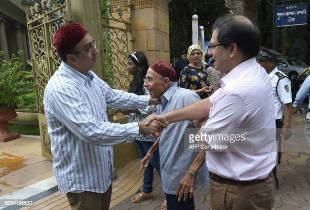 Indian Parsis exchange greetings outside a Fire Temple during Navroze the Parsi New Year in Mumbai on August 17 2017 Parsis followers of...