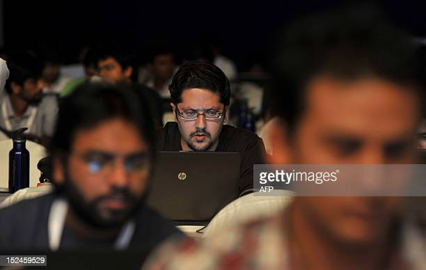 Indian participants take part in the 'Windows AppFest' a marathon coding for 18 hours by more than 3500 software developers organised by Microsoft in...