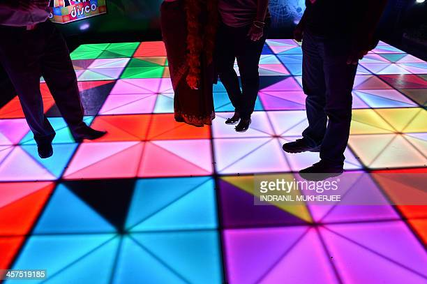 Indian partygoers are seen on the dancefloor during a yearend party in Mumbai on December 18 2013 AFP PHOTO/INDRANIL MUKHERJEE