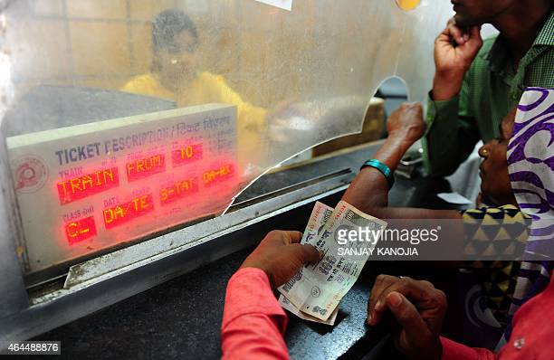 Indian passengers stand in a queue to buy railway tickets at Allahabad Junction in Allahabad on February 26 2015 India said it would spend 137...