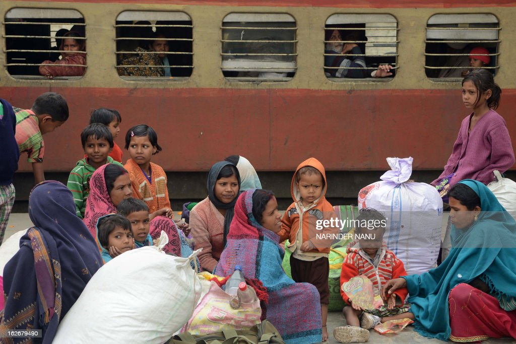 Indian passengers wait for their train at the railway station in Amritsar on February 26, 2013 as Railway Minister Pawan Kumar Bansal unveiled the railway budget in parliament. The railway, the country's largest employer with some 1.4 million people on its payroll, runs 11,000 passenger and freight trains and carries 19 million people daily. AFP PHOTO/NARINDER NANU