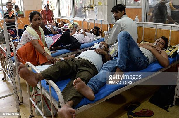 Indian patients share a bed in a dengue ward of Hindu Rao hospital in New Delhi on September 16 2015 The Indian capital is reeling from the worst...
