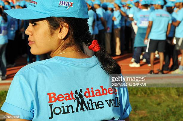Indian patients suffering diabetes and supporters participate in 'Beat Diabetes' a 5kms walkathon aimed at spreading awareness about diabetes in...