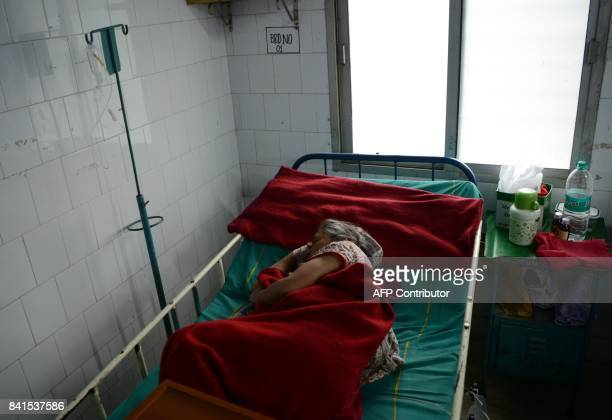 Indian patients undertaking treatment for viral infections including dengue fever are seen at Siliguri District hospital in Siliguri on September 1...