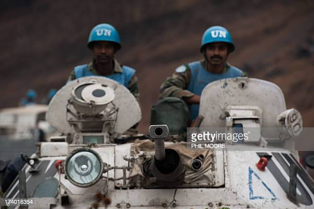Indian peacekeepers operating as part of the United Nations Stabilisation Mission for the Congo are pictured at the frontmost position behind...