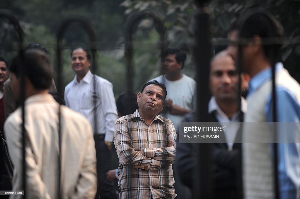 Indian pedestrians gather to watch as firefighters fight a blaze that broke out in a fifteen story building in New Delhi early November 19, 2012. No casualities were reported in the fire.