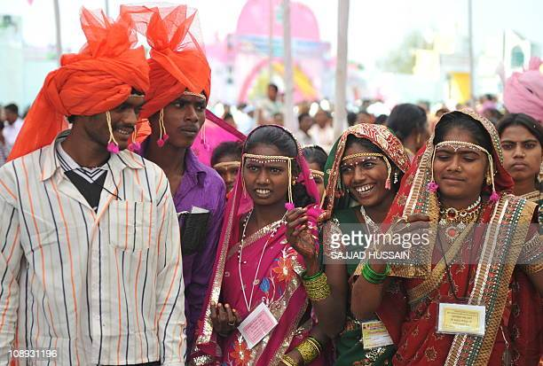 Indian people attend a mass wedding function at Amravati some 150km from Nagpur on February 2 2011 Some 2835 couples from various religions and...