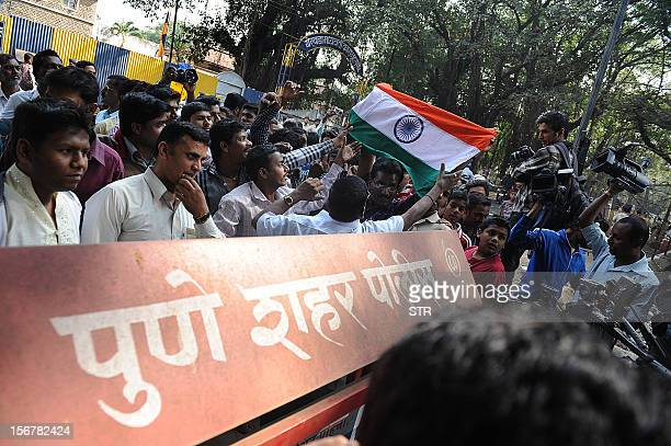 Indian people celebrate outside the highsecurity Yerwada Jail where Pakistanborn Mohammed Kasab the sole surviving gunman of the 2008 Mumbai attacks...