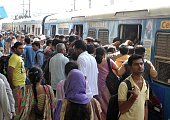Indian people crowd to get onto a local passenger train at a railway station in Secunderabad the twin city of Hyderabad on September 2 2015 Millions...