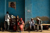 Indian people drink tea at a makeshift roadside tea stall in Gurgaon on the outskirts of New Delhi on April 9 2015 AFP PHOTO / Chandan KHANNA