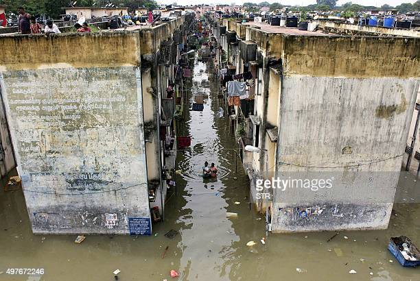 Indian people gather around a residential area that was flooded after heavy rains in Chennai on November 18 2015 Large areas of the southern Indian...