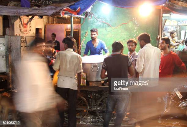 Indian people gather near a roadside traditional biriyani shop on the eve of Eid alFitr festival in Allahabad on June 252017