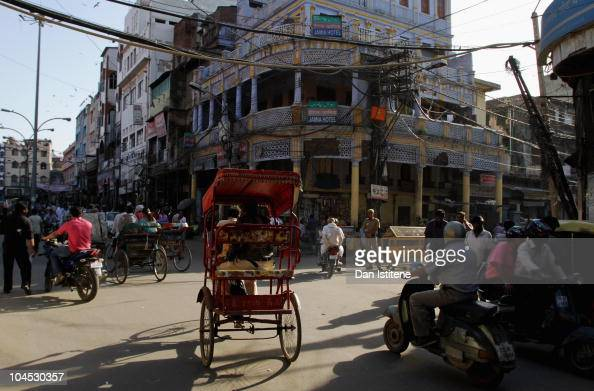 Indian people make their way down a street in Old Delhi on September 29 2010 in Delhi India