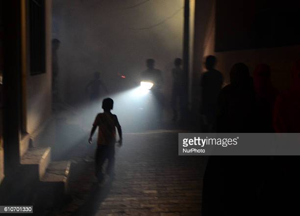 Indian people pass through smoke from fumigation in a busy old street of Allahabad on September 27201621 people died of dengue in last 3 weeks only...