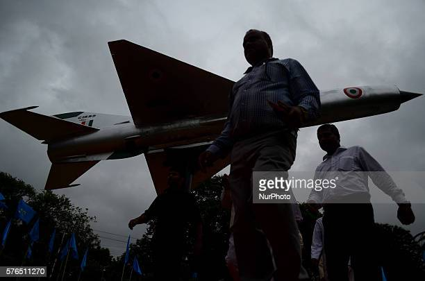 Indian people pass through the model of MIG 21 Fighter aircraft at ChandraShekhar Azad Parkin Allahabad on July 152016 MiG 21 aircraft C1599...