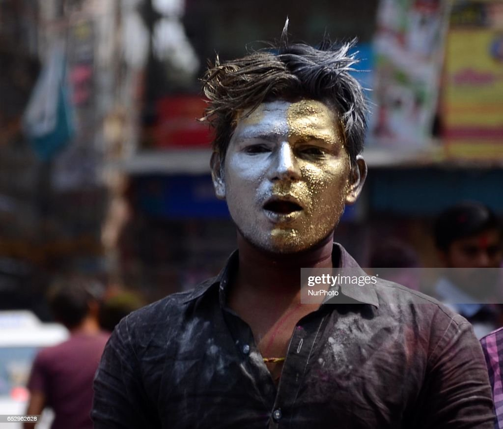 Indian People smear with colour powder during Holi festival in Kolkata, India on Monday, 13th March, 2017. Holi , festival of colours celebrated all over in India.