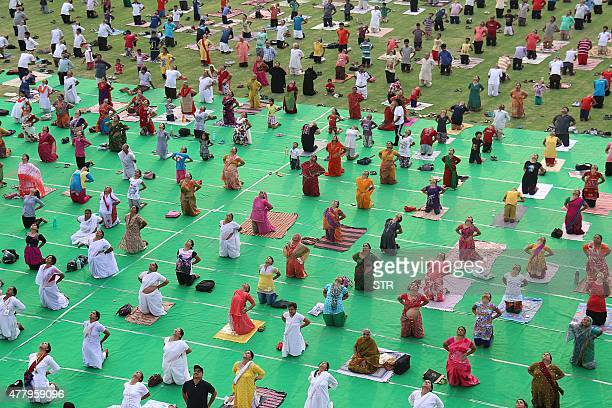 Indian people take part in a mass yoga session to mark the International Yoga Day at Umaid stadium in Jodhpur on June 21 2015 Prime Minister Narendra...