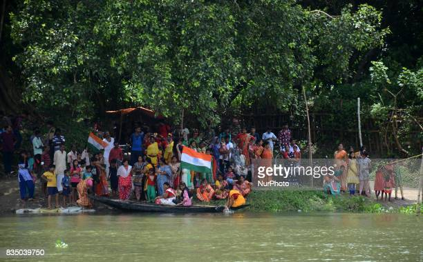 Indian people watching Independence Day celebration in Shivnibas Nadia district 95 km from Kolkata India on Friday 18th August 2017 While the entire...