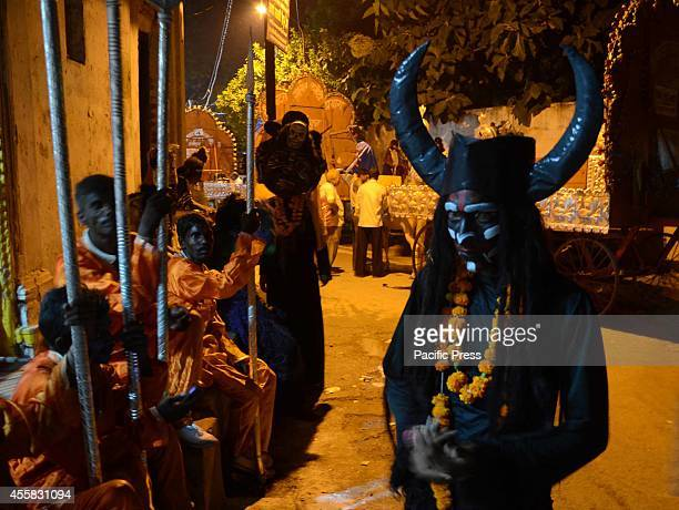 Indian performers dressed as Asura participating in the 'Ravan ki Barat' religious procession in Allahabad The procession was held to mark Dussehra...