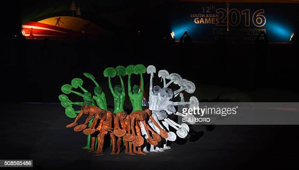 Indian performers take part in a cultural event during the opening ceremony of the 12th South Asian Games 2016 at Indira Gandhi Athletic Stadium in...