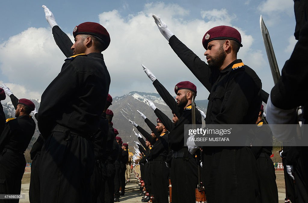 Indian personnel from the Jammu and Kashmir Armed Police (JKAP) take an oath in their passing out parade at the Sheeri training centre, some 65 km northwest of Srinagar, on February 24, 2014. Anger at Indian security forces runs deep in Muslim-majority Kashmir, where they are often blamed for grave rights abuses like widespread torture, rape, custodial murder and enforced disappearences in the region, which is divided and administered separately by India and Pakistan but claimed in full by both. AFP PHOTO/Tauseef MUSTAFA