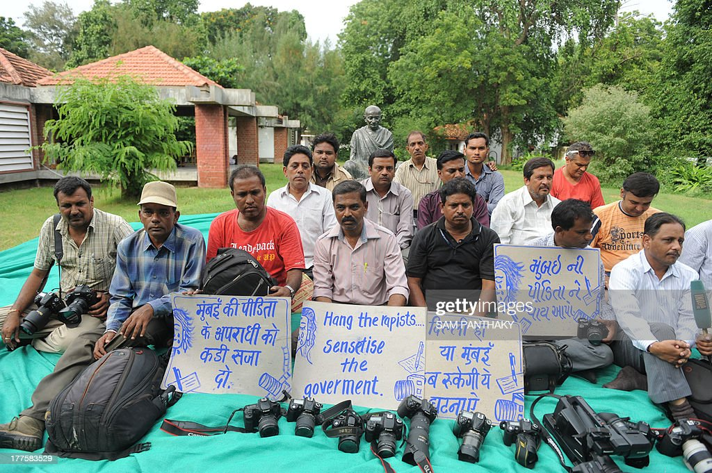 Indian photographers and journalists stage a protest against the gang-rape of a female colleague in Mumbai, at the Mahatma Gandhi Ashram in Ahmedabad on August 24, 2013. Mumbai police arrested a second man on accusations of gang-raping a female photographer in the Indian financial hub - an attack that has renewed anger over the country's treatment of women. AFP PHOTO/ Sam PANTHAKY