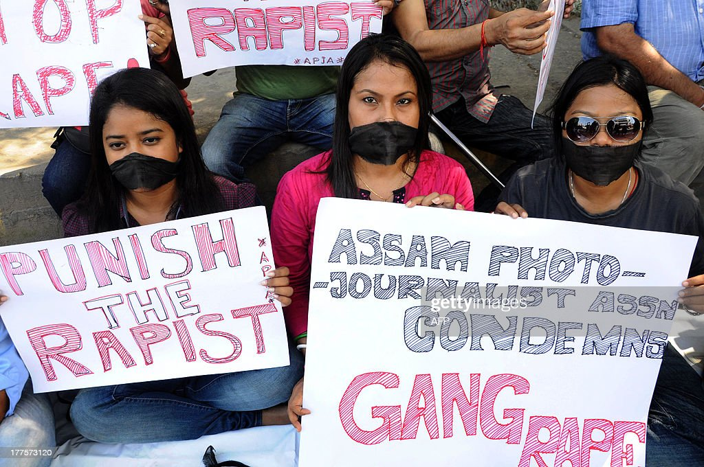 Indian photojournalists and journalists stage a protest against the gang-rape of a female colleague in Mumbai, in Guwahati on August 24, 2013. Mumbai police arrested a second man on accusations of gang-raping a female photographer in the Indian financial hub - an attack that has renewed anger over the country's treatment of women. AFP PHOTO/Biju Boro