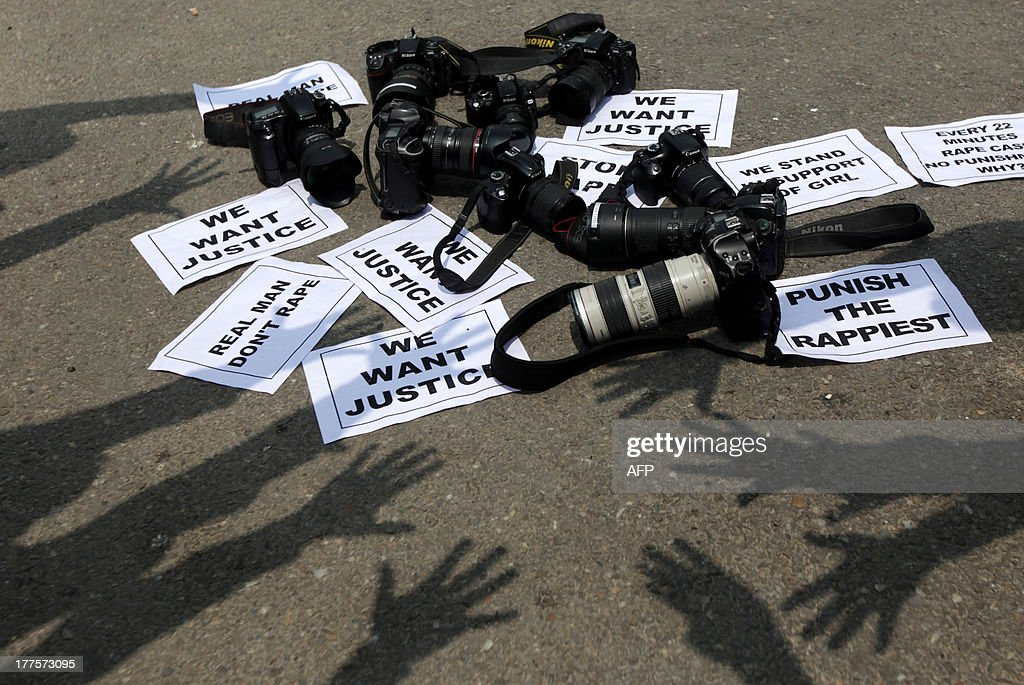 Indian photojournalists stage a protest against the gang-rape of a female colleague in Mumbai, in Jammu on August 24, 2013. Mumbai police arrested a second man on accusations of gang-raping a female photographer in the Indian financial hub -- an attack that has renewed anger over the country's treatment of women. AFP PHOTO/Rakesh BAKSHI