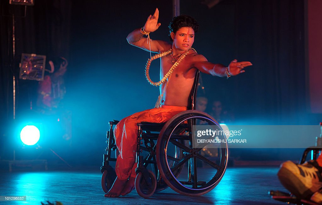 Indian physically challenged artists perform the Indian epic Ramayana in wheelchairs during a function in Bangalore on May 28, 2010. NGO Abilities Unlimited works with artists who suffer conditions such as polio, dyslexia, cerebral palsy and autism and is the first professional dance�theater troupe in India to educate and employ people with disabilities through choreographed works and public performances that integrate the arts with career opportunities and training. AFP PHOTO/Dibyangshu Sarkar