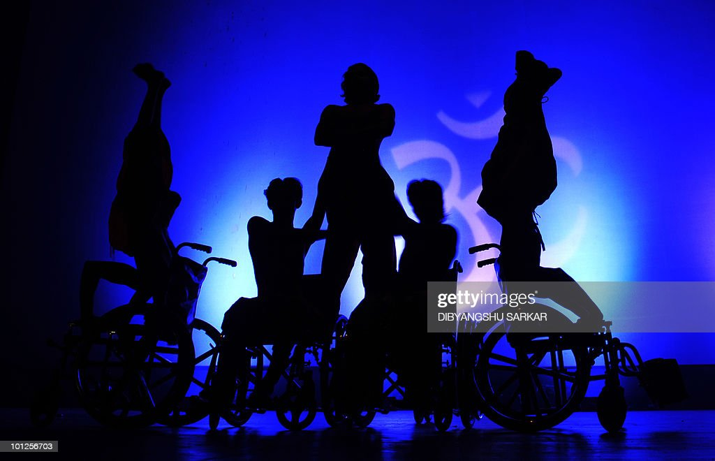 Indian physically challenged artists perform yoga on their wheelchairs during a function in Bangalore on May 28, 2010. NGO Abilities Unlimited works with artists who suffer conditions such as polio, dyslexia, cerebral palsy and autism and is the first professional dance�theater troupe in India to educate and employ people with disabilities through choreographed works and public performances that integrate the arts with career opportunities and training. AFP PHOTO/Dibyangshu Sarkar