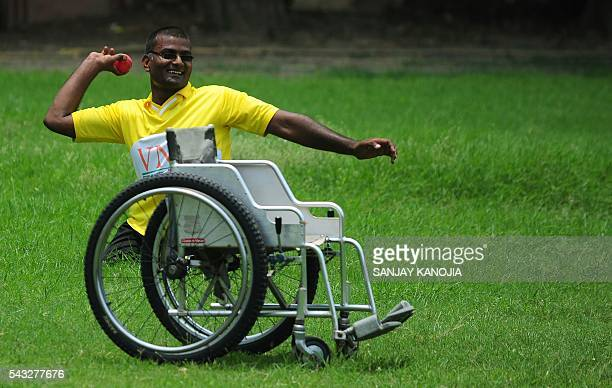 TOPSHOT Indian physically challenged players play cricket in wheelchairs during a twoday match between the Delhi and Uttar Pradesh teams in the...