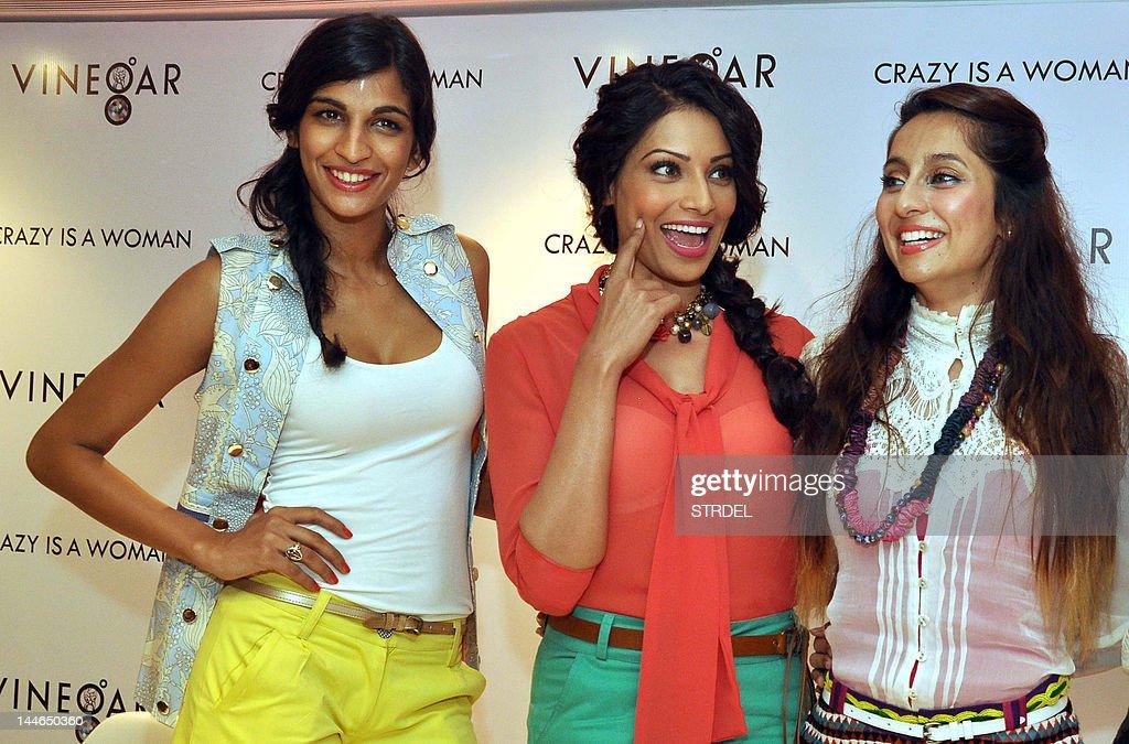 Indian playback singer Anushka Manchanda, (L) actress Bipasha Basu (C) and model and actress Anusha Dandekar pose during the inauguration of the 'Vinegar' show room in Mumbai on May 16, 2012.