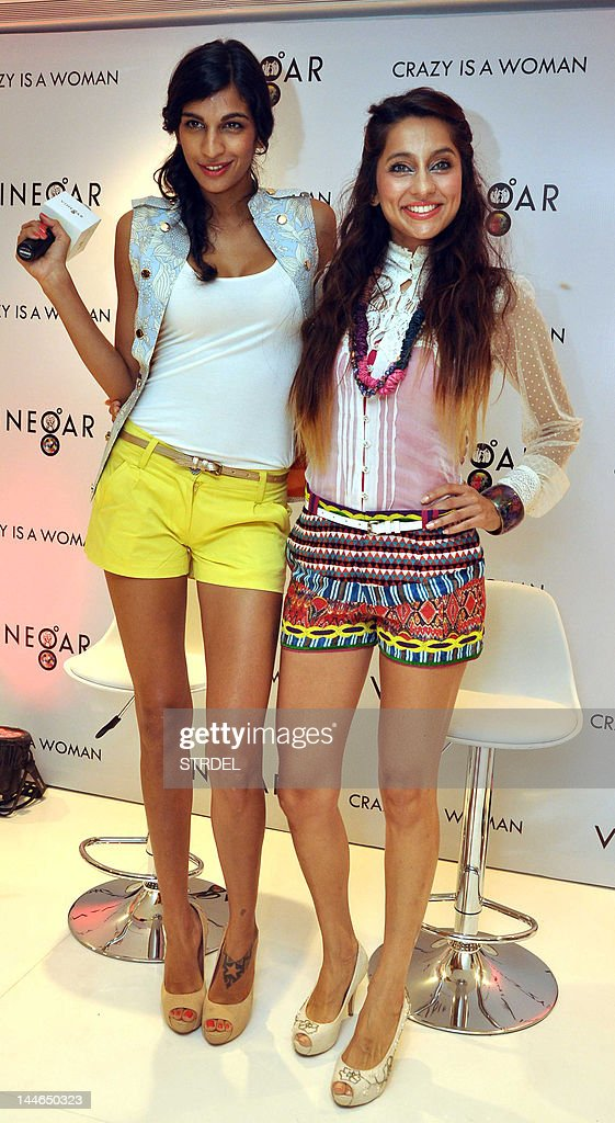 Indian playback singer Anushka Manchanda (L) and model and actress Anusha Dandekar pose during the inauguration of the 'Vinegar' show room in Mumbai on May 16, 2012.