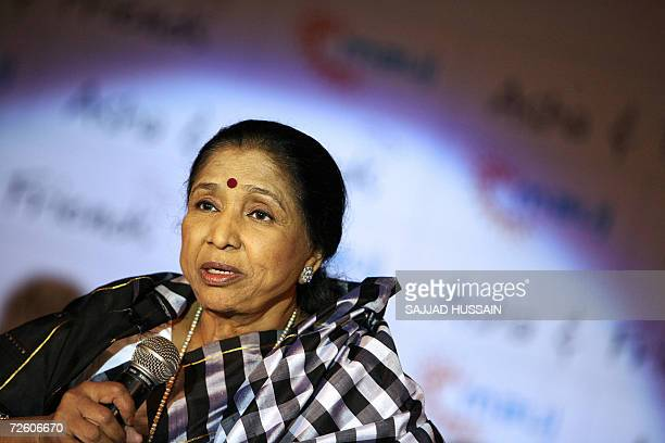 Indian playback singer Asha Bhosle speaks at the music launch of the album 'Asha and Friends' in Mumbai 20 November 2006 Indian actor Sanjay Dutt who...
