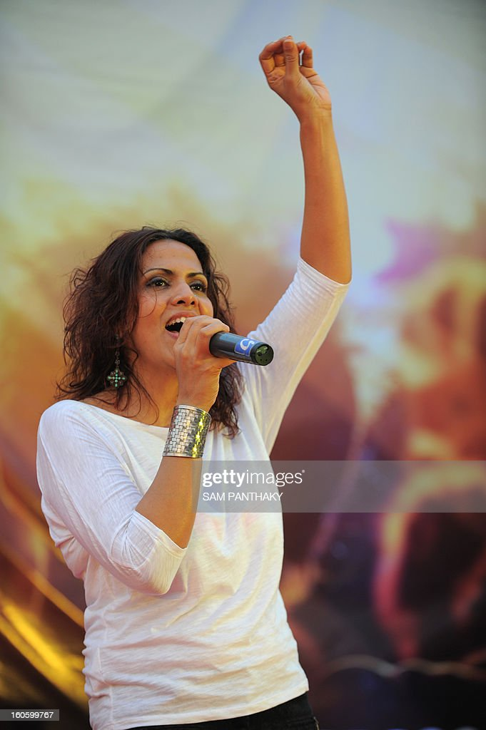 Indian playback singer Caralisa Monteiro performs during an anti-tobacco rock concert on the outskirts of Ahmedabad on the eve of World Cancer Day, February 3, 2013. Live performances were performed by Luke Kenny, Caralisa Monteiro and other co-stars of 'Rise Of The Zombie Night'. AFP PHOTO / Sam PANTHAKY