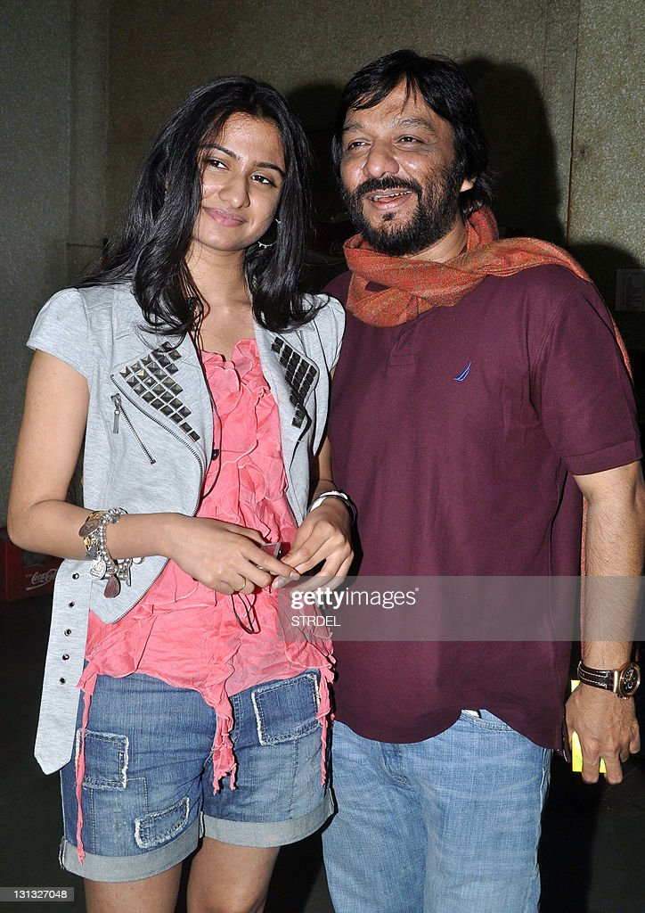 Indian playback singer Roop Kumar Rathod (R) and his daughter Riva pose during the Mriya Art and Entertainment Music Moncert in Mumbai on November 3, 2011.