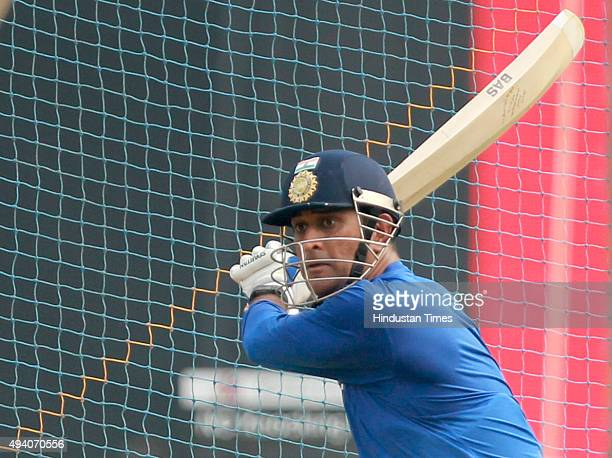 Indian player Mahendra Singh Dhoni in action during the practice session at Wankhede Stadium on October 24 2015 in Mumbai India After winning the...