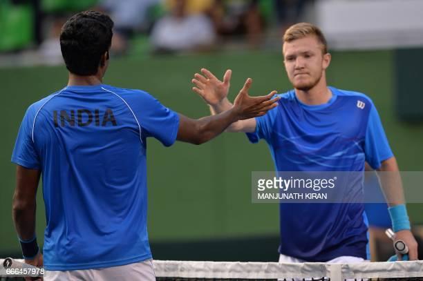 Indian player Prajnesh Gunneswaran and Uzbekistan's Temur Ismailov shake hands after the latter won their singles match during the Davis Cup Asia...