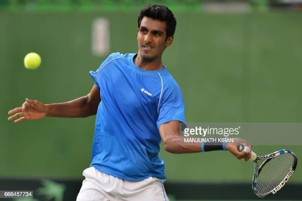 Indian player Prajnesh Gunneswaran plays a shot during his singles match against Uzbekistan's Temur Ismailov at the Davis Cup Asia Oceania group one...